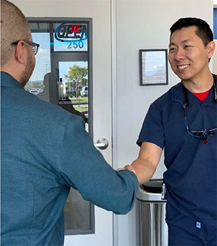 Dentist Dr. Daniel Kou with a patient in Frisco TX